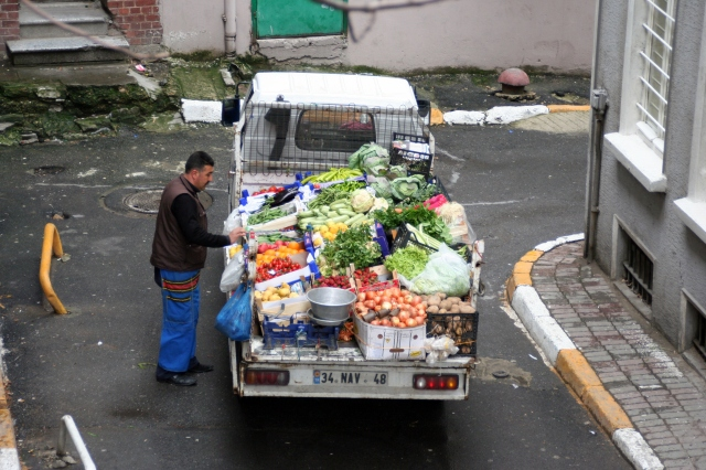 Morning street vendor below our apartment